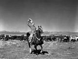 Gene Autry Riding a Horse and Holding a Western Hat Photo by  Movie Star News