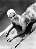 Carole Landis on a Printed Swimsuit Lying on a Dive Board Photo by  Movie Star News