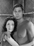 Johnny Weissmuller hugging a Woman while Topless Photo by  Movie Star News
