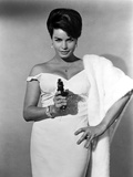 Senta Berger standing in White Dress with Pistol Photo by  Movie Star News