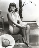 Paulette Goddard Seated wearing White Bikini Photo by  Movie Star News