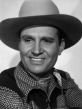 Gene Autry smiling in Checkered Shirt and Cowboy Hat Photo by  Movie Star News