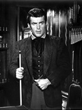 Robert Conrad standing in Black Coat With Stick Photo by  Movie Star News