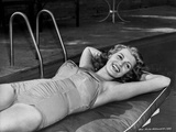 Rita Hayworth smiling with Hands Behind Her Head Photo by  Movie Star News