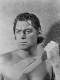 Johnny Weissmuller Holding Knife in Black and White Photo by  Movie Star News