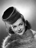 Joan Bennett on a Furry Cloth on Top and smiling Photo by  Movie Star News