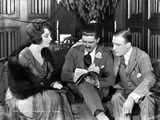 Betty Blythe sitting and Discussing with Two Men Photo by  Movie Star News