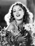 Billie Dove smiling in Floral Outfit Portrait Photo by  Movie Star News