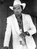 Powers Boothe Posed in White Suit With Bottle Photo by  Movie Star News