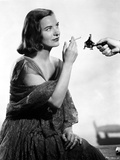 Ella Raines on a Dress and Lighting a Cigarette Photo by  Movie Star News