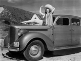 Rita Hayworth posed on the Car in Black and White Photo by  Movie Star News
