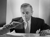 George Raft in Black Suit Lighting a Cigarette Photo by E Bachrach
