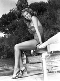 Rita Hayworth smiling and Seated on Diving Board Photo by  Movie Star News