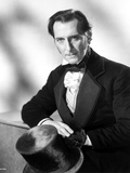 Peter Cushing sitting on Chair With Arm's Cross Photo by  Movie Star News