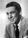 Mike Wallace smiling in Suit With White Background Photo af Movie Star News