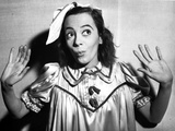 Imogene Coca wearing a silk Dress and Looking Up Photo by  Movie Star News