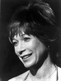 Shirley MacLaine smiling in Headshot Portrait Photo by  Movie Star News