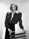 Irene Dunne on Diamond Printed Top standing Portrait Photo by  Movie Star News