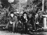 Marx Brothers sitting on a Bench in Black and White Photo by  Movie Star News