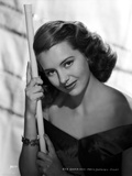 Cyd Charisse Posed in Black Dress with Bracelet Photo by  Movie Star News