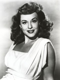 Paulette Goddard smiling in White Dress Portrait Photo by  Movie Star News