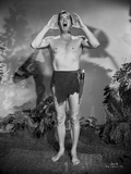 Johnny Weissmuller Shouting in Black and White Photo by  Movie Star News