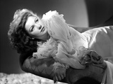 Anne Baxter on a Ruffled Dress Lying and posed Photo by  Movie Star News