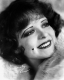 Clara Bow smiling in Fur Dress with Mole on Right Cheeks Photo by ER Richee