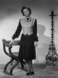 Myrna Loy standing in Long Sleeve Dress with Vest Photo by Gaston Longet