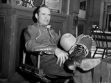 Gene Autry Seated on Chair with his Legs Crossed Photo by  Movie Star News