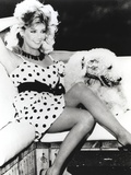 Heather Locklear wearing a Polka Dot Dress with Dog Photo by  Movie Star News
