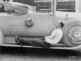 Buster Keaton posed on a Vintage Car in a Suit Photo by  Movie Star News