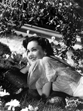 Maureen O'Sullivan Lying on the Grass and smiling Photo by  Movie Star News