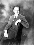 John Barrymore sitting on a Chair with Legs Crossed Photo by  Movie Star News