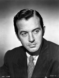 John Payne wearing a Suit in a Classic Portrait Photo by  Movie Star News