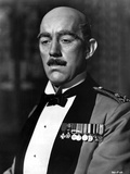 Alec Guinness Posed in Official Attire With Medals Photo by  Movie Star News