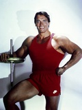 Arnold Schwarzenegger posed in Red Gym Outfit Photo by  Movie Star News