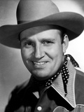 Gene Autry smiling in a Black and White Portrait Photo by  Movie Star News
