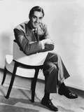 Tyrone  Powers Siting on Couch Black and White Photo by  Movie Star News