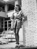 Rita Hayworth wearing a Skirt in a Looking Up Pose Photo by  Movie Star News
