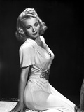 Carole Landis on a Dress sitting and Reclining Photo by  Movie Star News