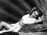 Maria Montez Lying in Bed, wearing White Sexy Dress Photo by  Movie Star News