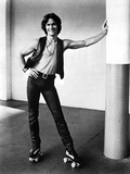 Patrick Swayze Leaning on Wall With Black and White Photo by  Movie Star News