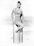 Esther Williams Leaning on Surfboard in Swimsuit Photo by  Movie Star News
