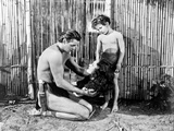 Johnny Weissmuller Kneeling in Black and White Photo by  Movie Star News