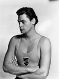 Johnny Weissmuller wearing a Tank top in a Portrait Photo by  Movie Star News