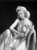 Carole Landis on a Silk Dress sitting and posed Photo by  Movie Star News