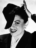 Judy Garland portrait with tipped hat on head Photo by  Movie Star News
