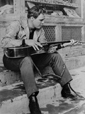 Marlon Brando Playing Guitar in Black and White Photo by  Movie Star News