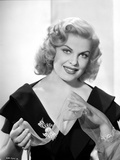 Cleo Moore smiling in Black Dress with Bracelet Photo by  Movie Star News
